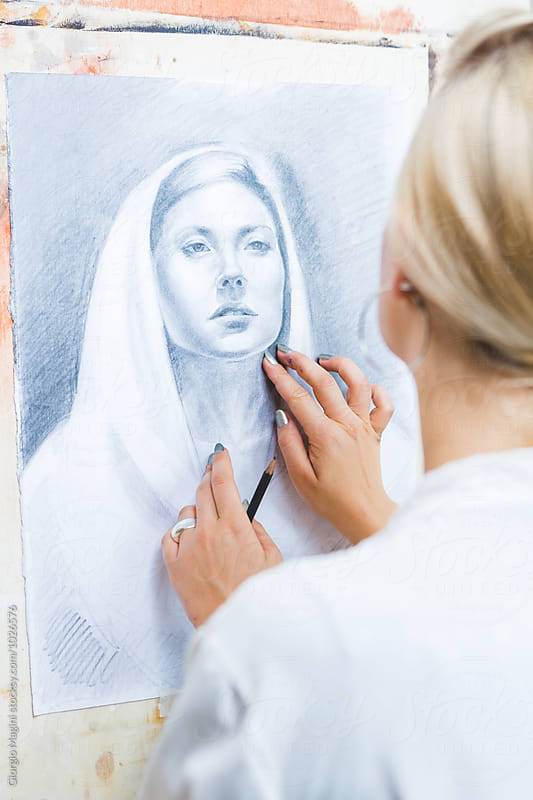 Young Artist Making a Portrait on Paper with a Pencil by Giorgio Magini for Stocksy United