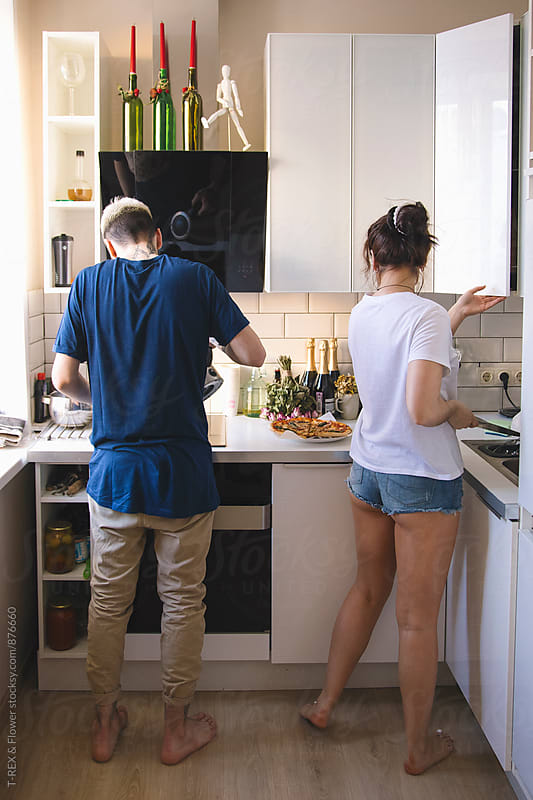 Back view of couple preparing food in the kitchen  by Danil Nevsky for Stocksy United