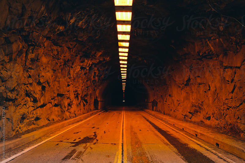 Tunnel through the mountain by Jesse Morrow for Stocksy United