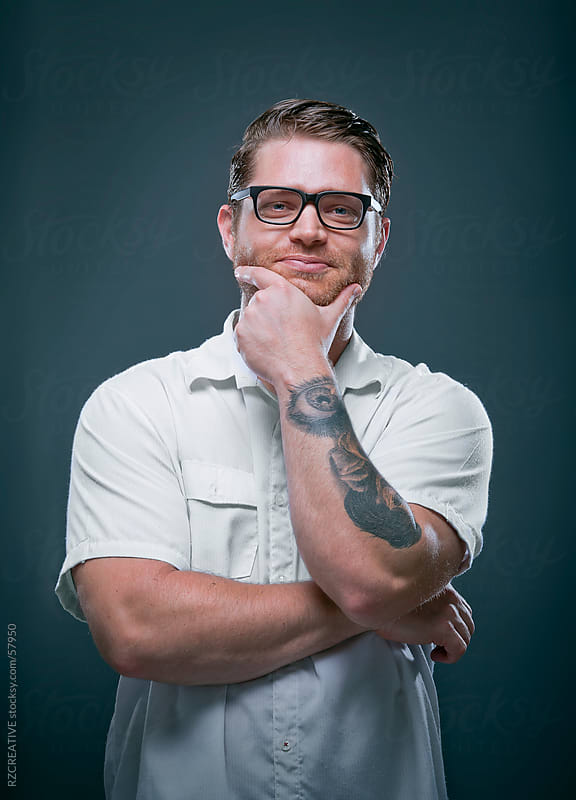 Studio portrait of a man smiling and looking at the camera. by Robert Zaleski for Stocksy United
