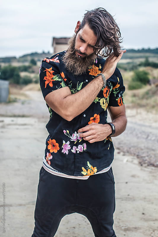 young hipster man in colored shirt by Igor Madjinca for Stocksy United