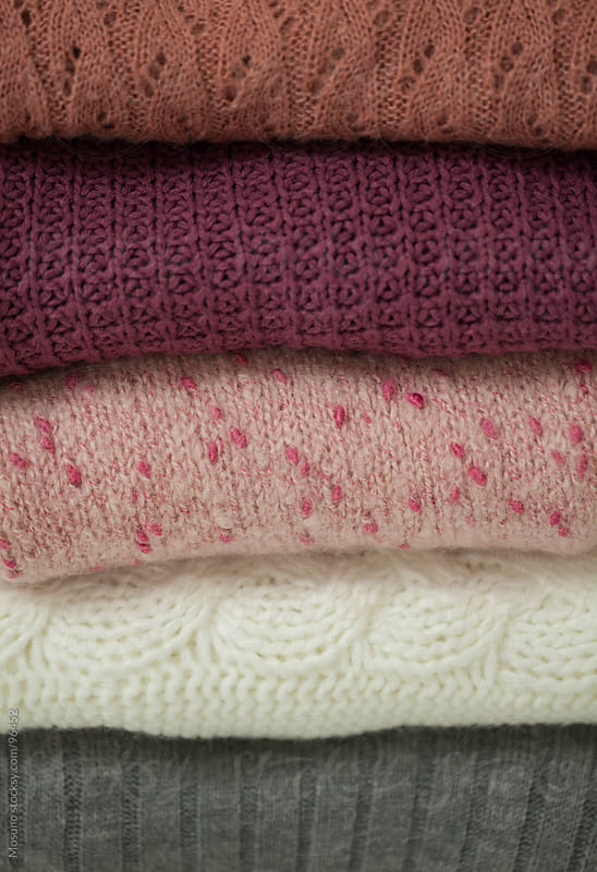 Pile of Sweaters as a Background by Mosuno for Stocksy United