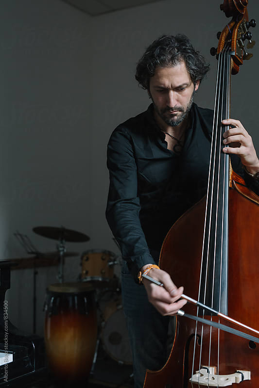 Portrait of double bass musician by Alberto Bogo for Stocksy United