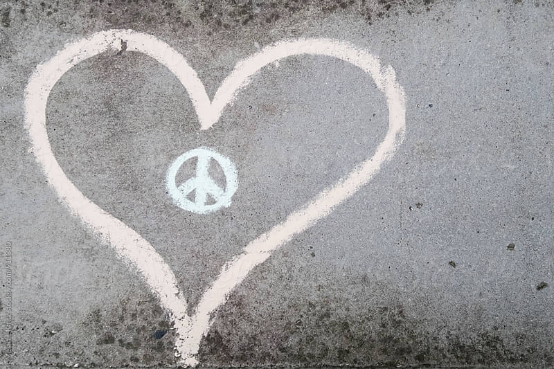 Heart and peace symbol on grey concrete by Melanie Kintz for Stocksy United