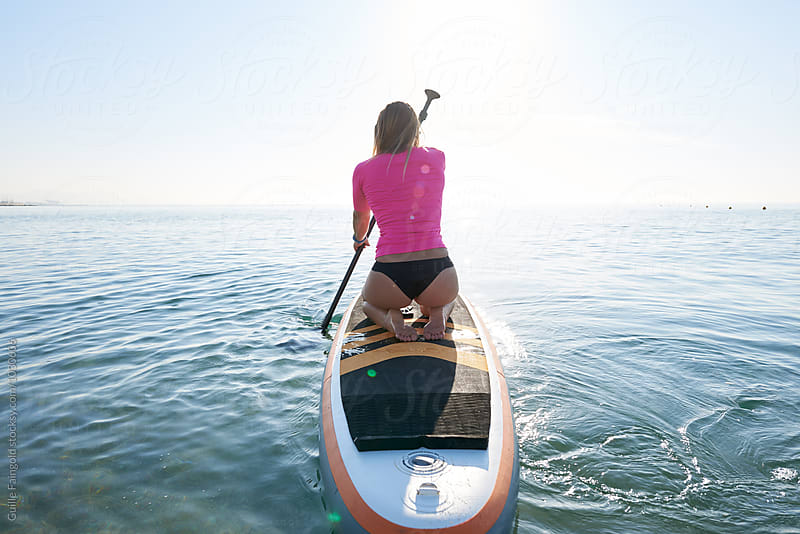 paddle surf by Guille Faingold for Stocksy United