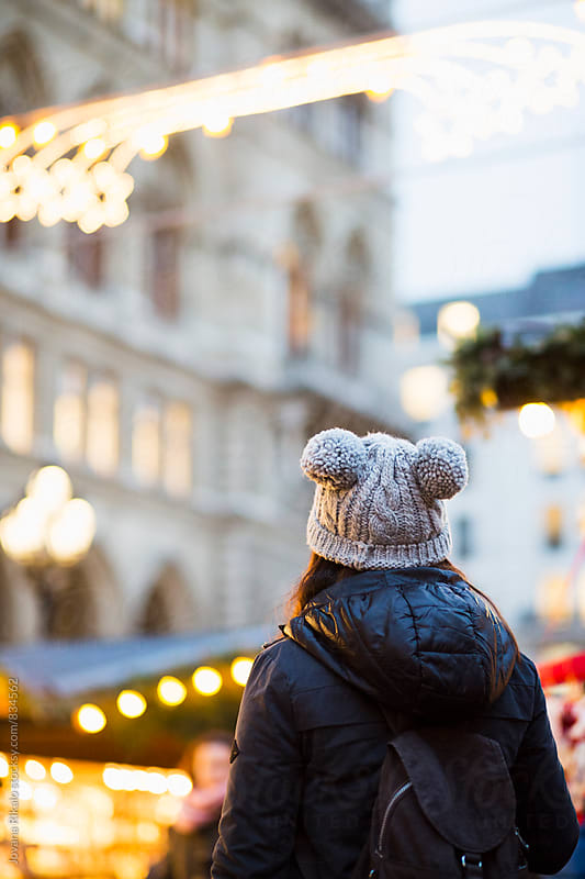 Back view of a woman watching Christmas decorations by Jovana Rikalo for Stocksy United