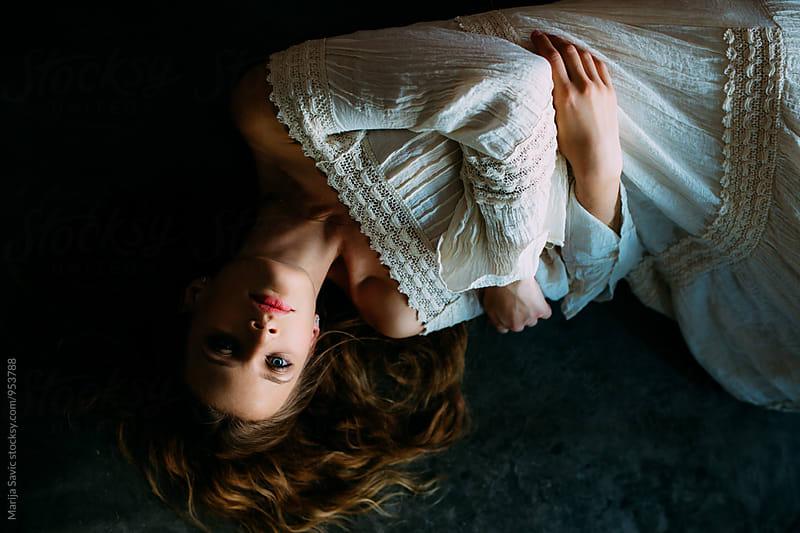 Woman in dark by Marija Savic for Stocksy United