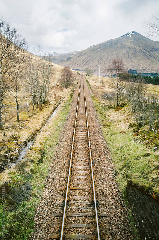 A straight railroad in the Scottish Highlands by Ivo de Bruijn for Stocksy United