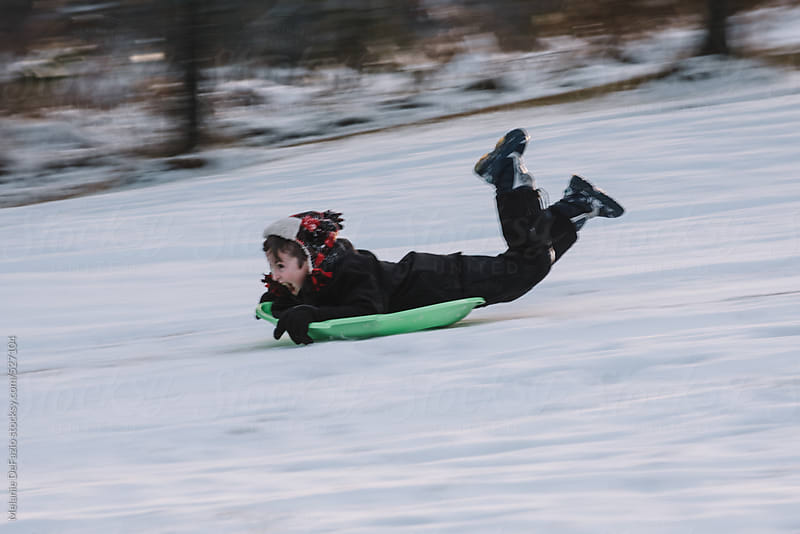 sledding by Melanie DeFazio for Stocksy United