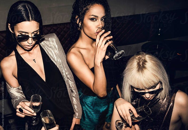 Cheers!/Stylish girls having great time at party. by Marko Milanovic for Stocksy United