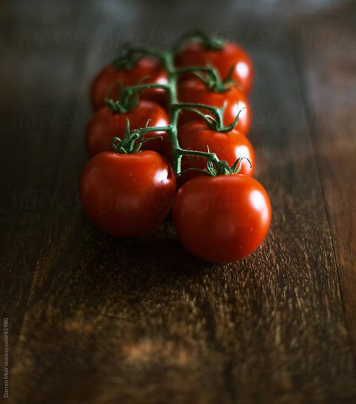 Ripe vine tomatoes  by Darren Muir for Stocksy United