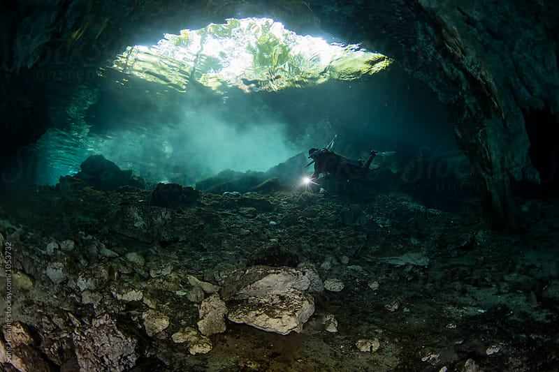 A scuba diver swimming in Mexico's  Cenote Gran by Song Heming for Stocksy United