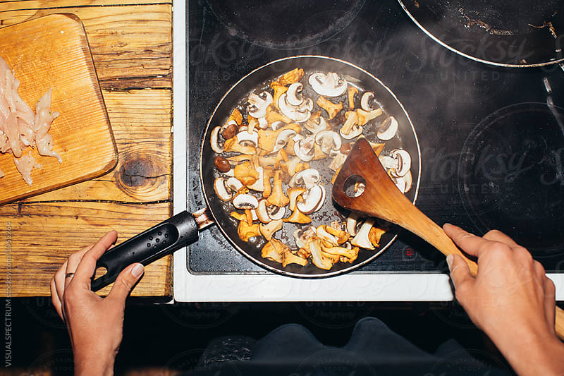 Overhead Closeup Shot of Woman Frying Porcini in Rustic Kitchen by Julien L. Balmer for Stocksy United