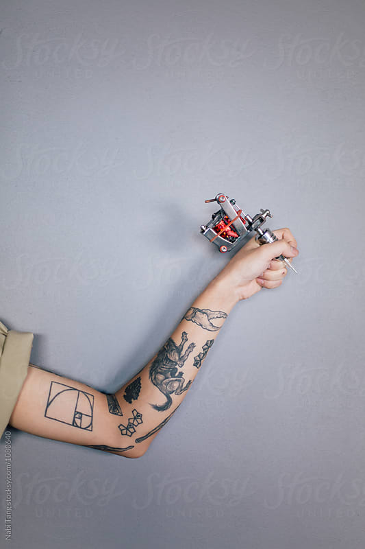 Artist hand holding tattoo gun by Nabi Tang for Stocksy United