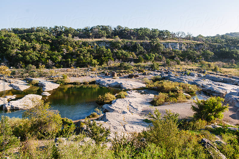 Peacefull river in the Texas Hill Country by Kristen Curette Hines for Stocksy United