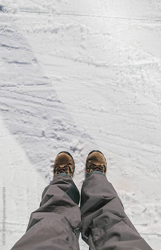 Man Standing on a Snowy Floor with Mountain Boots by VICTOR TORRES for Stocksy United