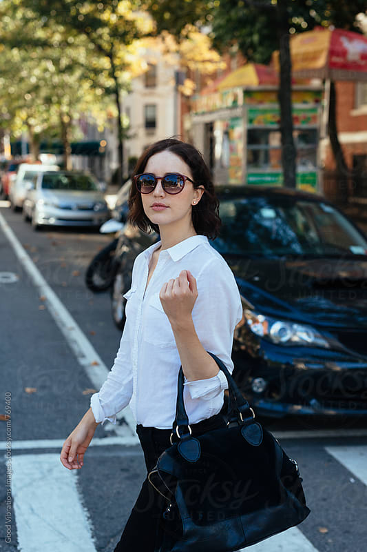 Brunette crossing the road in NYC by Good Vibrations Images for Stocksy United