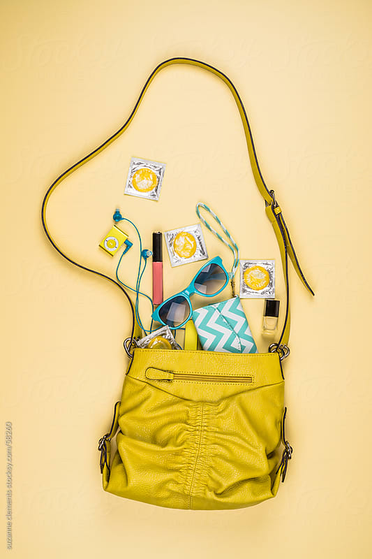 Woman's Purse Reveals Private Details about her Personality by suzanne clements for Stocksy United
