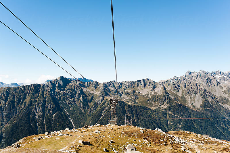 View from a cable car over mountains by Suzi Marshall for Stocksy United