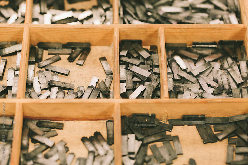 Lead Press Types on a Wooden Desk by VICTOR TORRES for Stocksy United