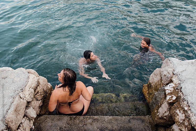 Three friends having fun on dock by Boris Jovanovic for Stocksy United