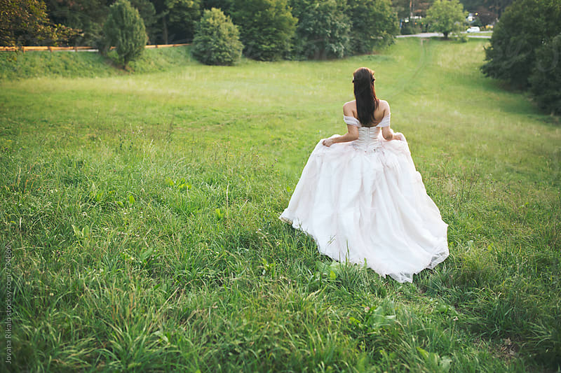 Beautiful bride in a romantic wedding dress by Jovana Rikalo for Stocksy United
