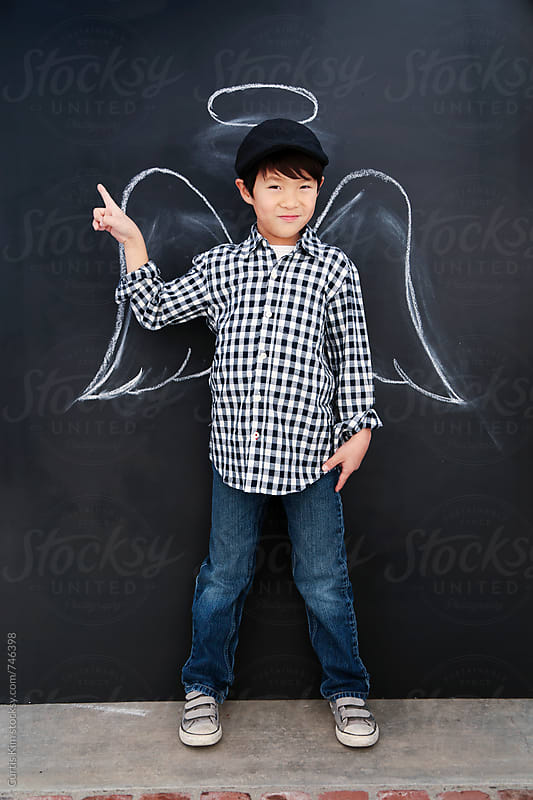 Handsome kid with angel wings and halo around his head by Curtis Kim for Stocksy United