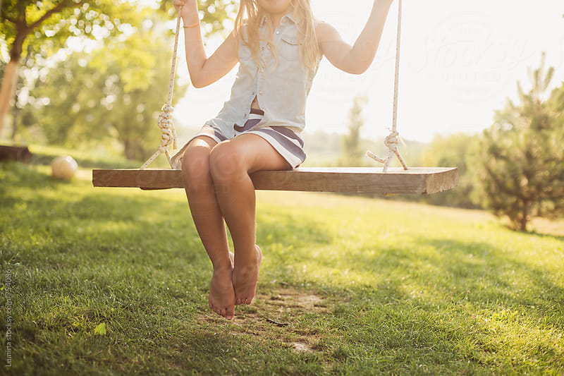 Caucasian Girl Sitting on a Swing  by Lumina for Stocksy United