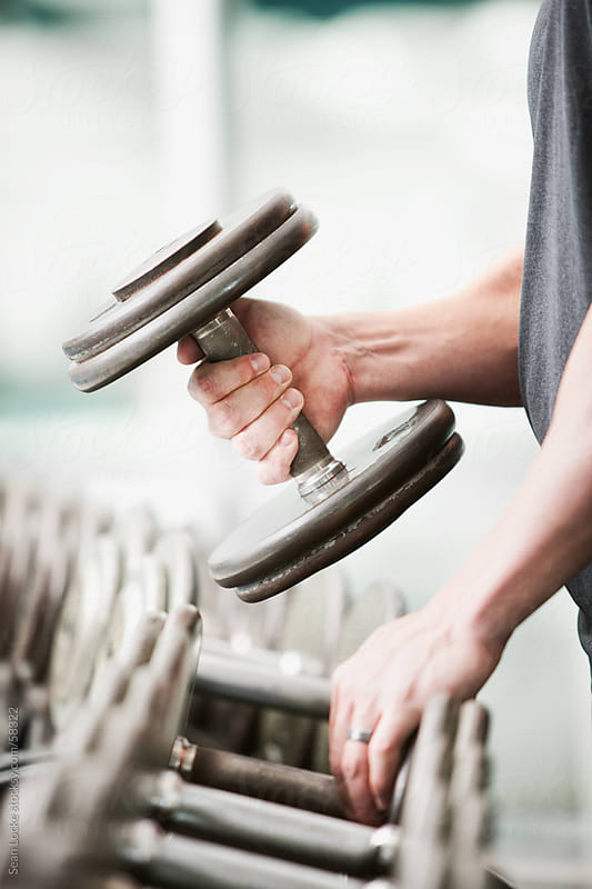 Gym: Picking Up a Dumbbell from Rack by Sean Locke for Stocksy United