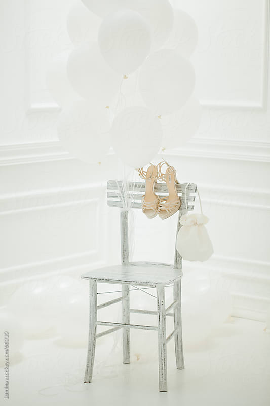 Bride's Shoes and Purse on a White Chair by Lumina for Stocksy United