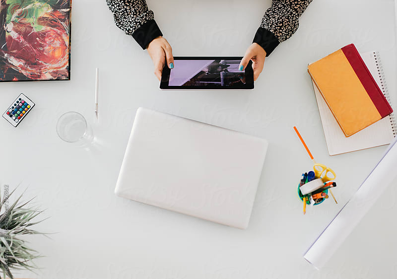 Work hard - woman using tablet on her work desk by Jovo Jovanovic for Stocksy United