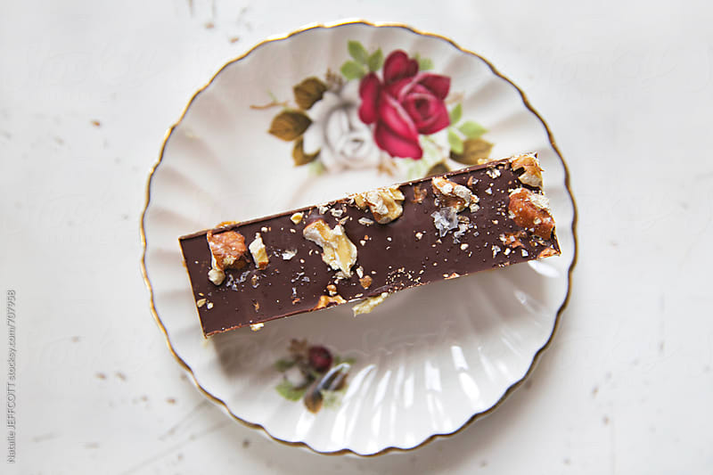 salted caramel slice for afternoon tea on a vintage rose plate by Natalie JEFFCOTT for Stocksy United