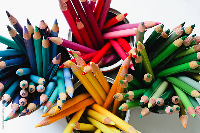 bright colored pencils in containers by Jess Lewis for Stocksy United