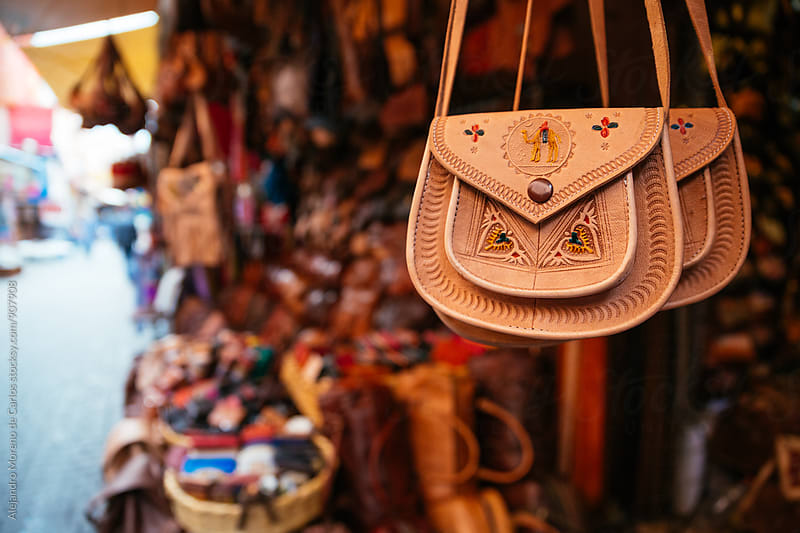 Leather handbags at Moroccan souk - market by Alejandro Moreno de Carlos for Stocksy United
