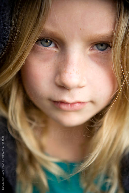 Intense Portrait Of Pre-Teen Green Eyed Girl by Dina Giangregorio for Stocksy United