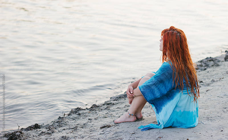 Portrait of a redhead model on the river coast by Evil Pixels Photography for Stocksy United