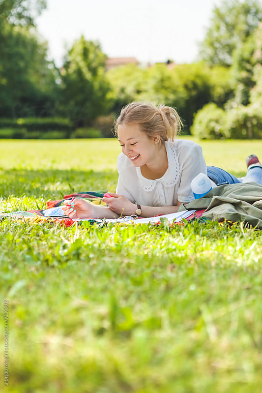 Teenage Girl Studying at the Park by Giorgio Magini for Stocksy United