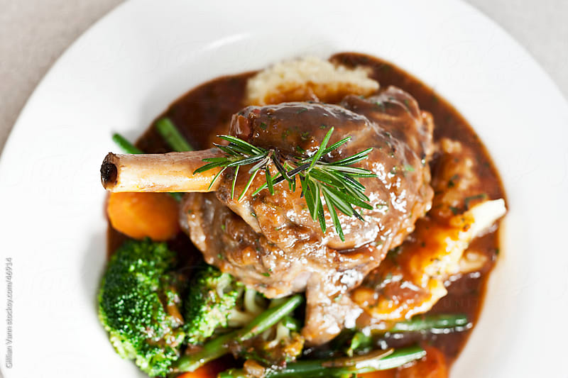 lamb shank meal by Gillian Vann for Stocksy United