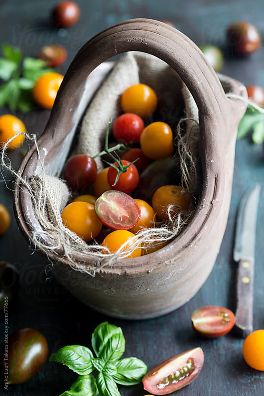 Tomatoes in basket by Aniko Lueff Takacs for Stocksy United