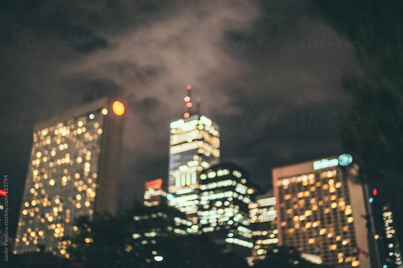 unfocused skyscrapers at night by Javier Pardina for Stocksy United