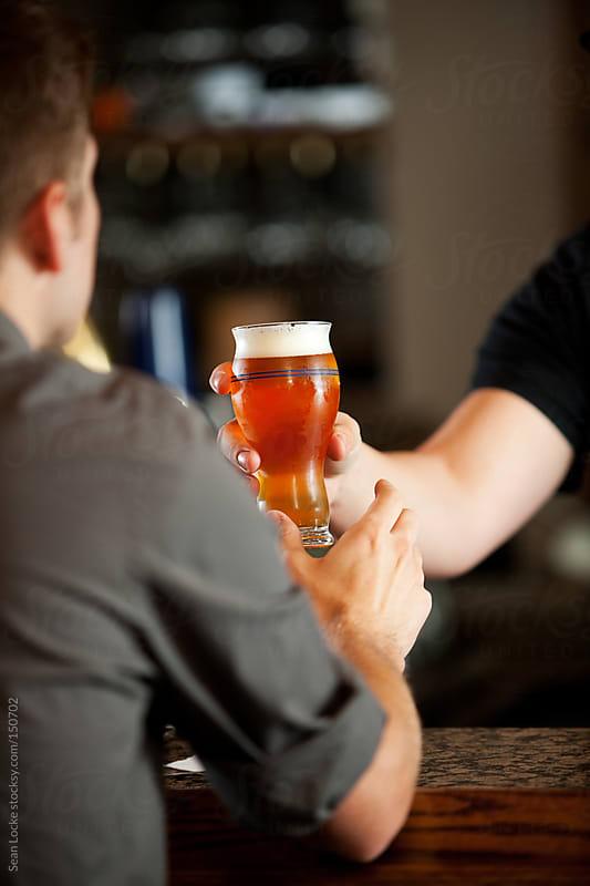 Bar: Man Receives a Beer by Sean Locke for Stocksy United