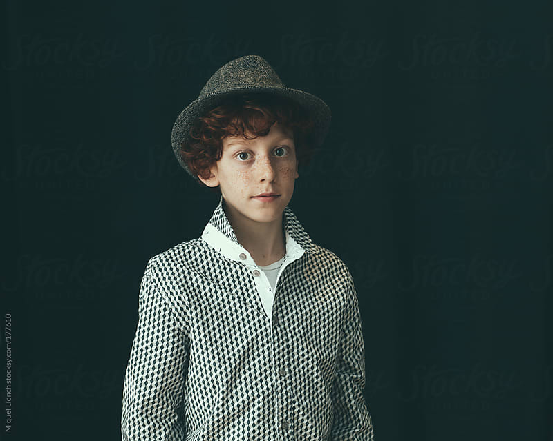 Portrait of boy with hat by Miquel Llonch for Stocksy United