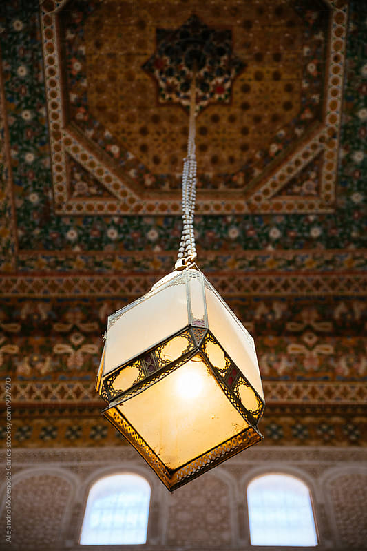 Lamp hanging in a room in Bahia Palace. Marrakech, Morocco by Alejandro Moreno de Carlos for Stocksy United