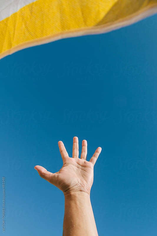 Open Hand Against a Radiant Blue Sky by VICTOR TORRES for Stocksy United