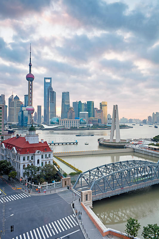 New Pudong skyline; Waibaidu (Garden) Bridge; looking across the Huangpu River from the Bund; Shanghai; China by Gavin Hellier for Stocksy United