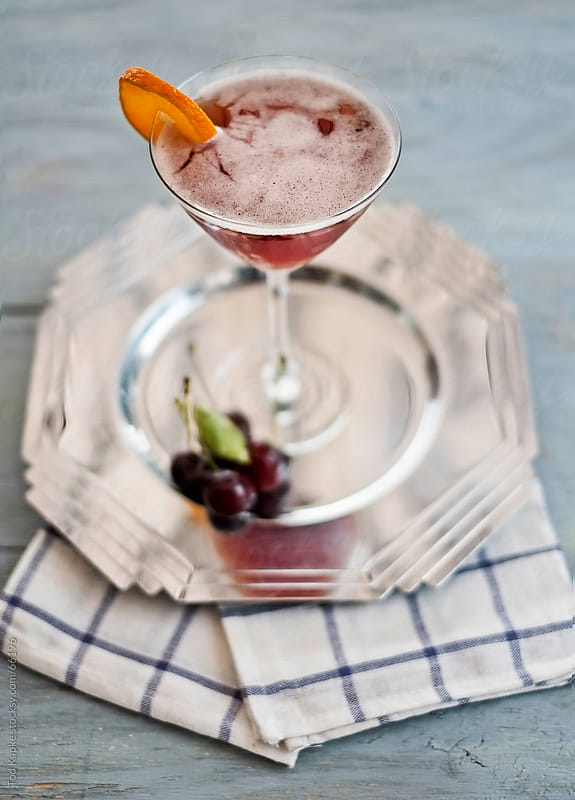 vintage cherry cocktail in martini glass by Tod Kapke for Stocksy United