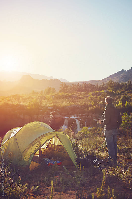 sunrise tent man by Daxiao Productions for Stocksy United
