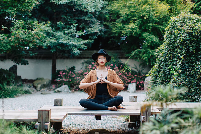 Healthy young woman meditating in lotus position by Jakob for Stocksy United