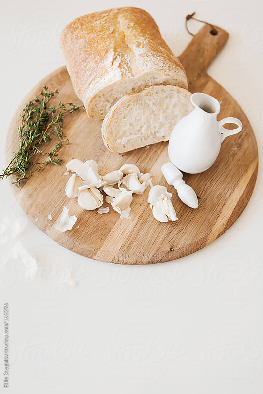Garlic toast prep by Ellie Baygulov for Stocksy United