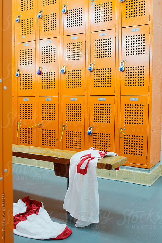 Basketball jersey discarded on bench in locker room by Tana Teel for Stocksy United